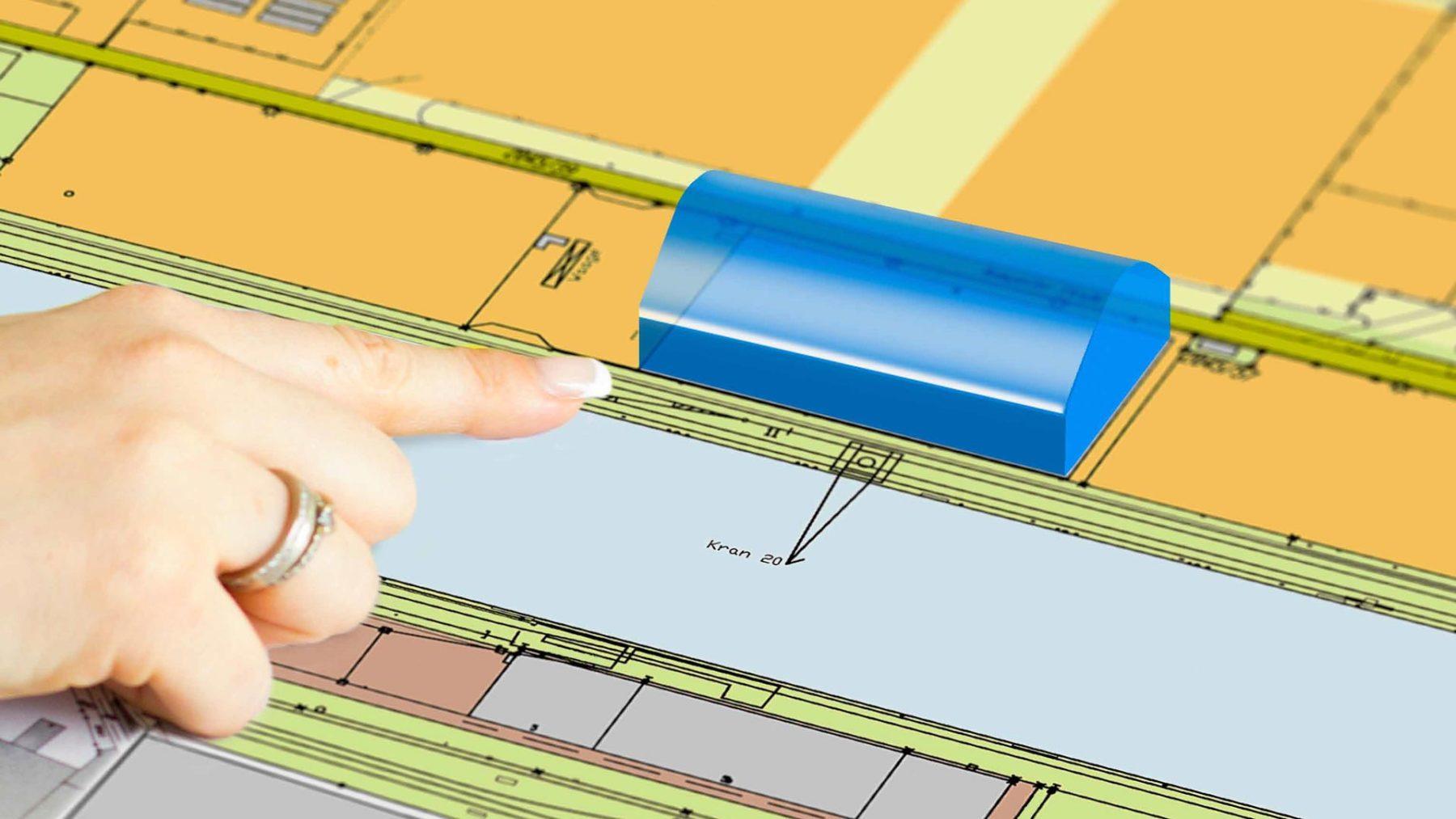 Finger deutet auf Virtuelle Halle in einem Bauplan